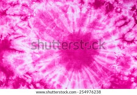 Pink tie dye batik fabric for background and texture - stock photo
