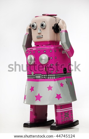pink tin wind up toy - stock photo