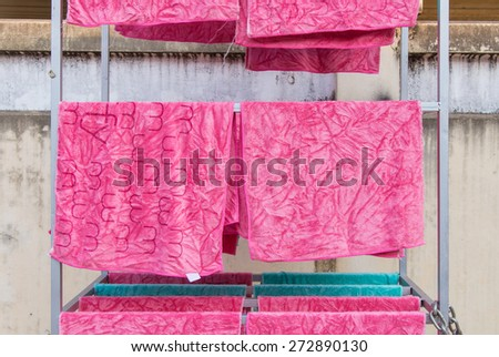 pink towel on clothesline in sunny day. - stock photo