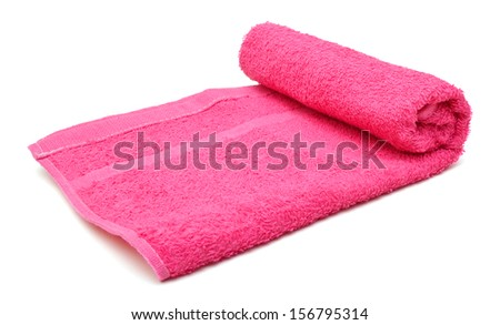 Pink towel rolled up on a white background  - stock photo