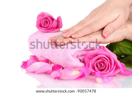 Pink towel with roses and hands on white background