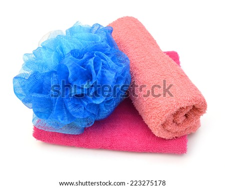 Pink towels and blue bath puff on white  - stock photo