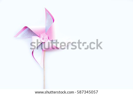 Pink toy pinwheel on white background