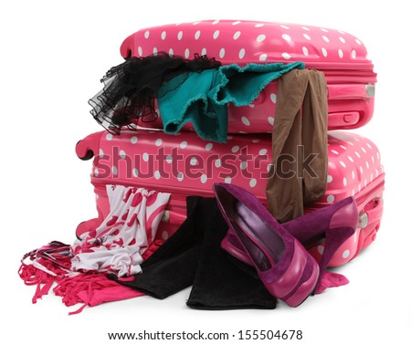 pink travel suitcase with personal belongings isolated on white - stock photo