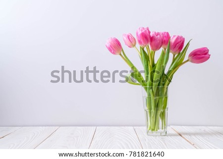 pink tulip flower on wood background with copy space
