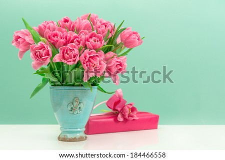 pink tulip flowers and gift box. festive arrangement