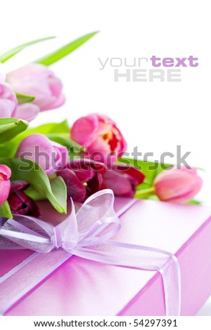 Pink tulips and gift box on a white background. With sample text. - stock photo
