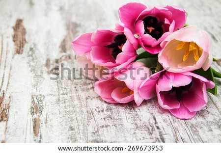 Pink tulips  on a old wooden background