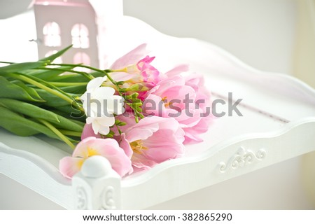 Pink tulips on white wooden background. Mother's day. March 8 - stock photo