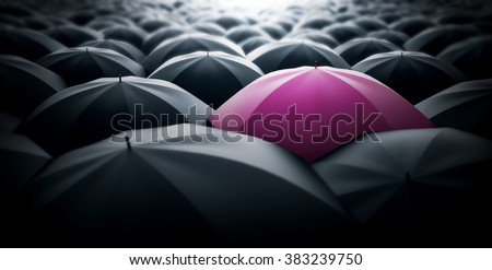 Pink umbrella sticking out of the crowd, women power concept representation - stock photo