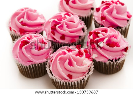 Pink Valentine's day cupcakes on white background.
