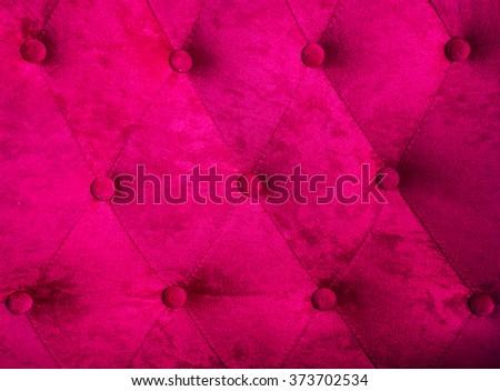 Pink velvet sofa background - stock photo