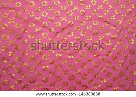 Pink vintage cloth with golden pattern - stock photo