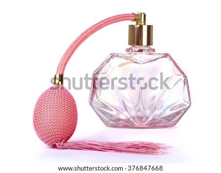 Pink vintage perfume bottle with atomizer isolated on white background. - stock photo