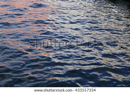 Pink violet and blue water. St.Petersburg Russia water canal surface.
