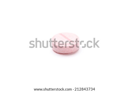 Pink vitamin on white background. Healthcare concept. - stock photo