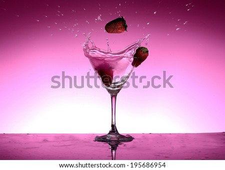 Pink Vodka in glass - stock photo