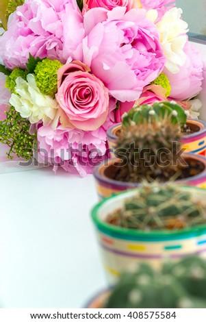 Pink wedding bouquet and kakstus - stock photo