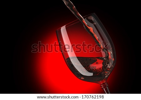 Pink wine being poured into glass - stock photo