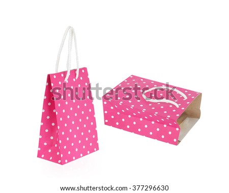 Pink with White polka dots paper bag isolated on white background with clipping path - stock photo