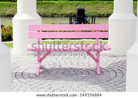 Pink wood chair in the park