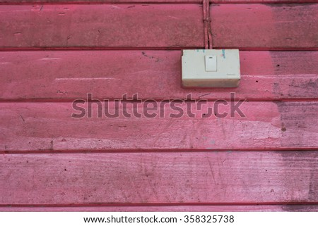 Pink wood wall with electric switch