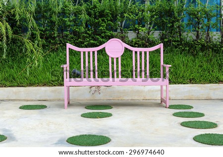 Pink wooden chairs in the park