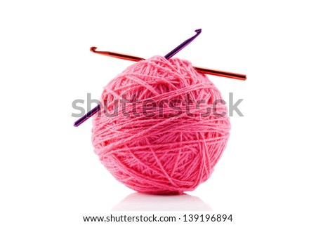 Pink yarn and crotchet hooks isolated on white - stock photo