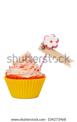 pink yellow isolated cupcake with label for your text - stock photo