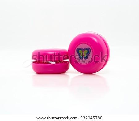 Pink yo-yo isolated on white background - stock photo