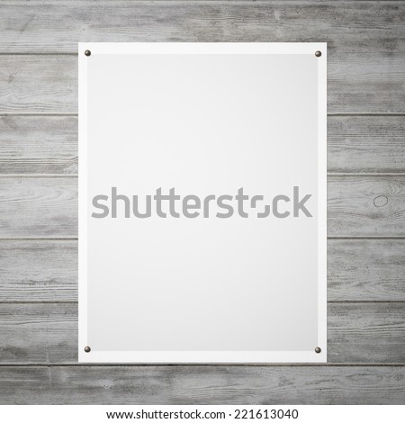 Pinned poster on a wood wall - stock photo