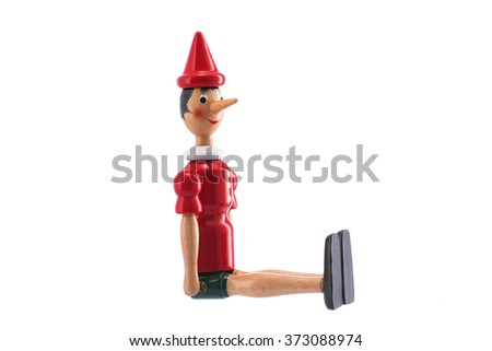 Pinocchio Toy Statue isolated on white background - stock photo