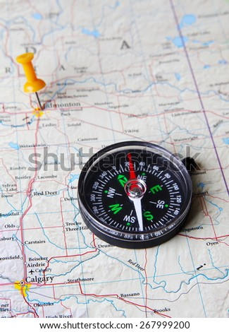 Pins and compass destination in the map - stock photo