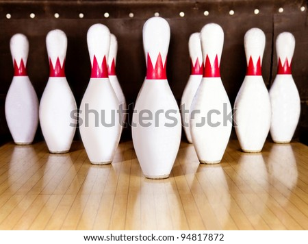 Pins at the end of a bowling alley - stock photo