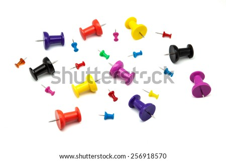 pins of different sizes and colors - stock photo