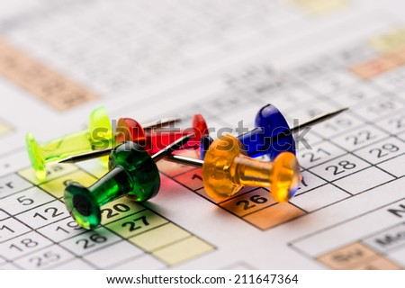 Pins on calendar - stock photo