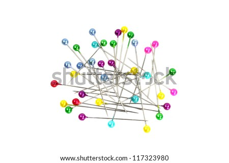 Pins with multicolored ball heads in pile isolated on white - stock photo