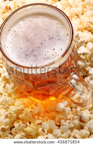 Pint of beer and popcorn with space for text