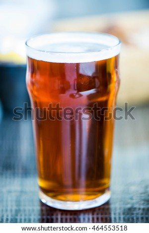 Pint of Bitter Beer in a Glass on a Table Setting
