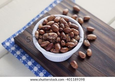 Pinto Beans. High angle view of white bowl full of Pinto Beans. Very shallow depth of field.