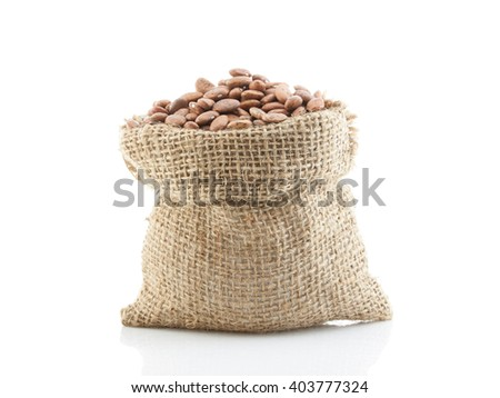 Pinto beans in a sack isolated on white