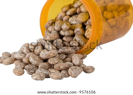 Pinto beans pouring from a pill bottle - stock photo