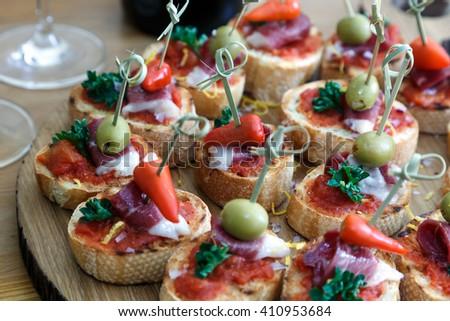 pintxos, tapas, spanish canapes party finger food - stock photo