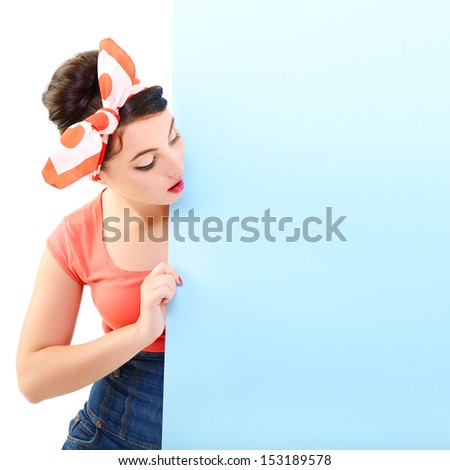 Pinup girl holding empty banner, portrait of young happy sexy woman in pin-up style - stock photo