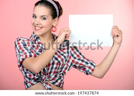 Pinup girl, portrait of young happy sexy woman in pin-up style, - stock photo