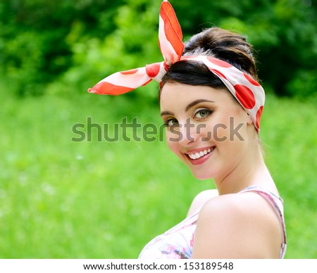 Pinup girl's portrait in summer park, young happy sexy woman in pin-up style over nature outdoor - stock photo
