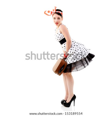 Pinup girl with suitcase in dress spotted, full length retro portrait of young happy sexy woman in pin-up style, vintage stylization over white - stock photo