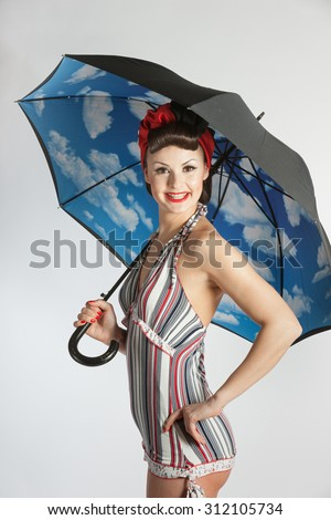 Pinup model with umbrella isolated on white background