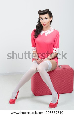 PinUp sexy girl with pink suitcase.  - stock photo