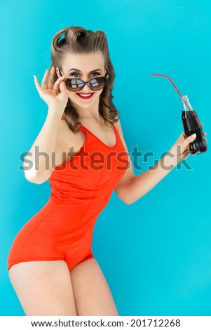 Pinup, summer. Attractive woman in red swimsuit - stock photo